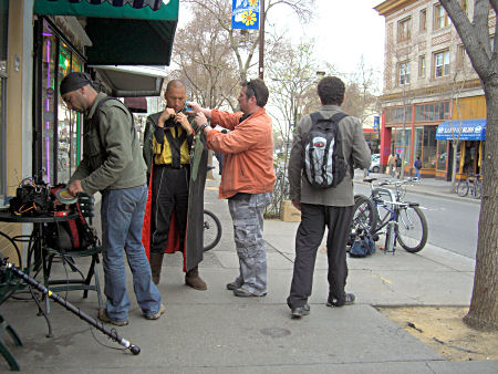 TV crew suiting up a interviewee.