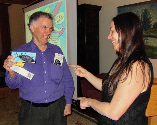 Charles Scamahorn of Earthark getting a Darwin Award sticker from Wendy Northcutt