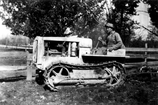 Photo of Glenn Eidemiller Sr. on his Caterpillar tractor