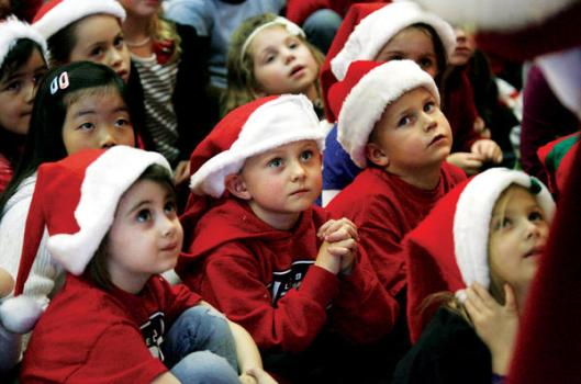 Kids in Santa Claus suits