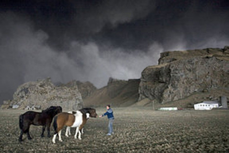 Farmer saves his horses from the fallout of a volcanic eruption