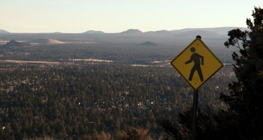 A traffic caution sign at the top of Pilot Butte, Oregon