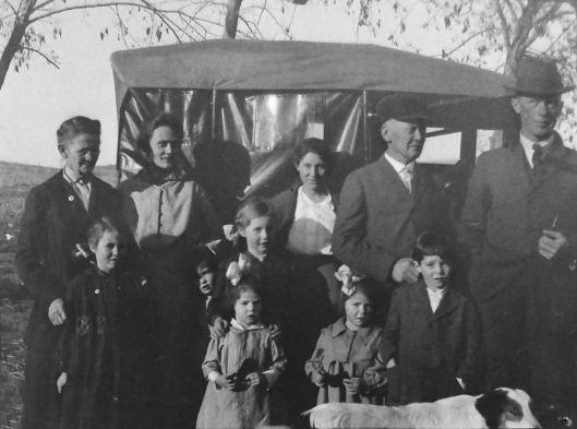 Bertha Lile (Aspinwall) Eidemiller with car