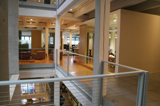 The open space creates levels of offices with natural lighting