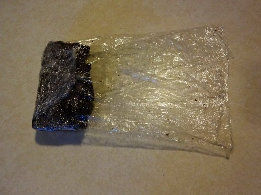 Here is a half eaten brownie wrapped at one end.