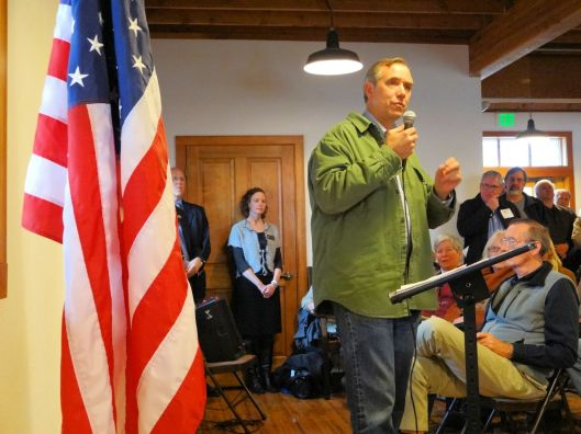 Senator Merkley speaks to the town hall meeting.