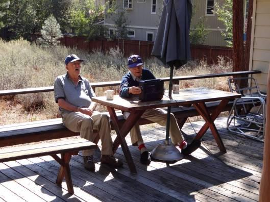 Old men listening to a raido