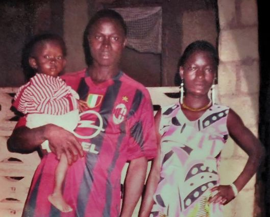 A family photo with Emile still in his father's arms.