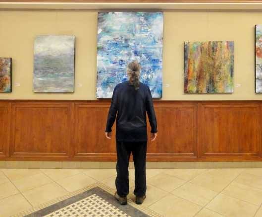 A man viewing art.